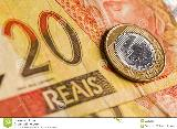 One Brazilian Real coin, over a 20 Real ...