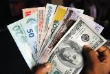 Reuters) – The Nigerian naira ...